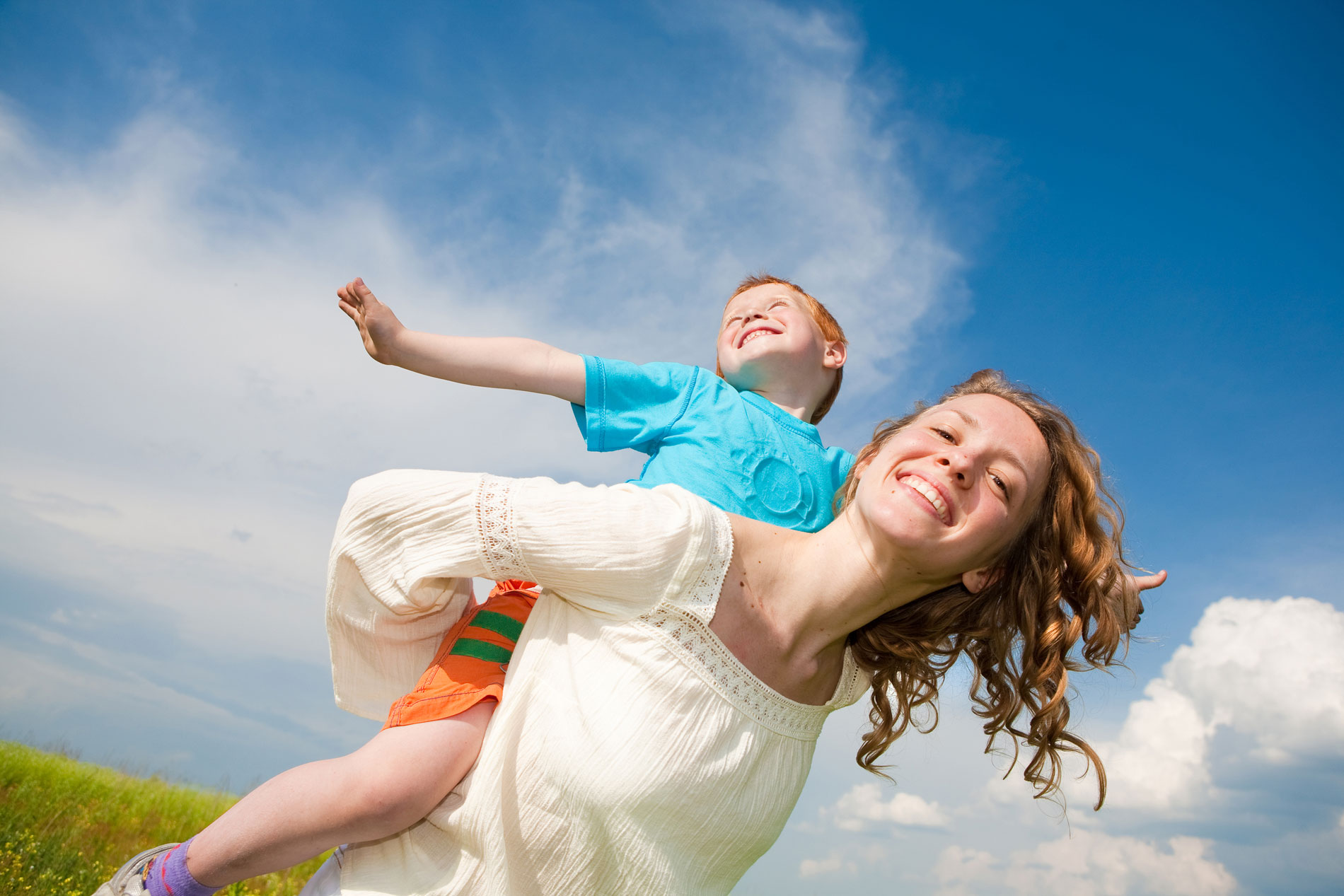 Mother and son having fun in open sky