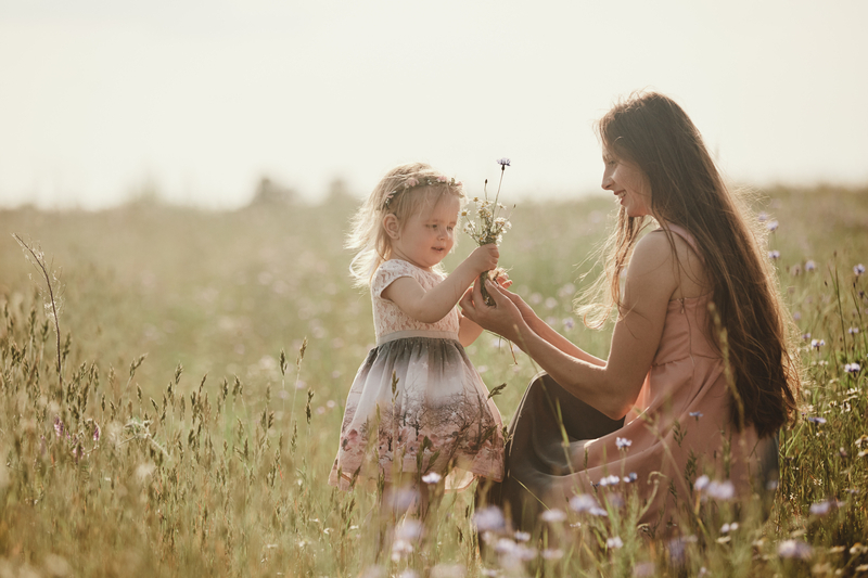 Mother giving flowers to her Daughter
